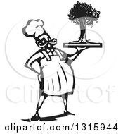Clipart Of A Black And White Woodcut Male Chef Holding A Tree On A Tray Royalty Free Vector Illustration