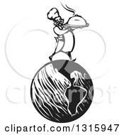 Clipart Of A Black And White Woodcut Male Chef Holding A Steaming Cloche Platter And Walking On Planet Earth Royalty Free Vector Illustration