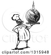 Clipart Of A Black And White Woodcut Male Chef Holding Planet Earth Birthday Cake With A Candle Royalty Free Vector Illustration