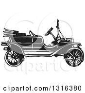 Clipart Of A Black And White Woodcut Antique Model T Car Royalty Free Vector Illustration