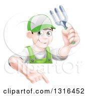 Clipart Of A Young Brunette White Male Gardener In Green Holding Up A Garden Fork And Pointing Down Over A Sign Royalty Free Vector Illustration