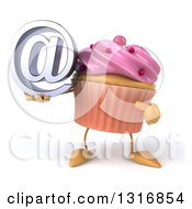 Clipart Of A 3d Pink Frosted Cupcake Character Holding And Pointing To An Email Arobase At Symbol Royalty Free Illustration
