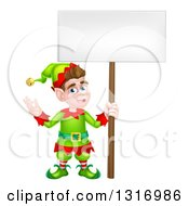 Clipart Of A Cartoon Happy Male Christmas Elf Holding A Blank Sign Royalty Free Vector Illustration