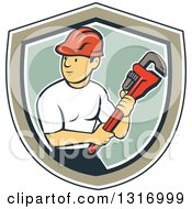 Retro Cartoon White Male Plumber Holding A Giant Monkey Wrench In A Navy Blue White Tan And Green Shield