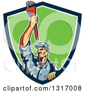Clipart Of A Retro White Male Plumber Holding Up A Monkey Wrench And Emerging From A Blue White And Green Shield Royalty Free Vector Illustration