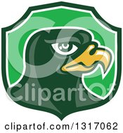 Clipart Of A Retro Falcon Head In A Green Shield Royalty Free Vector Illustration by patrimonio