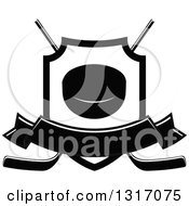 Clipart Of A Black And White Hockey Puck Inside A Shield Over Crossed Sticks With A Blank Banner Royalty Free Vector Illustration