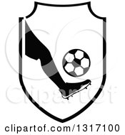 Black And White Soccer Ball Players Foot Kicking A Ball In A Shield