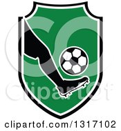 Clipart Of A Soccer Ball Players Foot Kicking A Ball In A Shield Royalty Free Vector Illustration by Vector Tradition SM