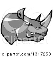 Clipart Of A Cartoon Angry Gray Rhinoceros Head In Profile 2 Royalty Free Vector Illustration by Seamartini Graphics