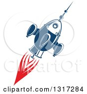 Clipart Of A Retro Blue Rocket With Red Flames 3 Royalty Free Vector Illustration by Vector Tradition SM