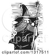 Clipart Of A Black And White Woodcut Wizard With A Staff Royalty Free Vector Illustration by xunantunich