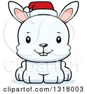 Animal Clipart Of A Cartoon Cute Happy White Christmas Rabbit Wearing A Sant Hat Royalty Free Vector Illustration
