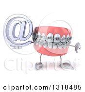 Clipart Of A 3d Metal Mouth Teeth Mascot With Braces Giving A Thumb Down And Holding An Email Arobase At Symbol Royalty Free Illustration