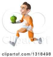 Clipart Of A 3d Young Brunette White Male Super Hero In An Orange Suit Sprinting To The Left With A Green Bell Pepper Royalty Free Illustration
