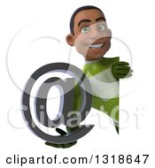 Clipart Of A 3d Young Black Male Super Hero In A Green Suit Holding An Email Arobase At Symbol Around A Sign Royalty Free Illustration