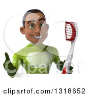 Clipart Of A 3d Young Black Male Super Hero In A Green Suit Giving A Thumb Up And Holding A Giant Toothbrush Over A Sign Royalty Free Illustration