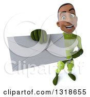 Clipart Of A 3d Young Black Male Super Hero In A Green Suit Holding Up An Envelope Royalty Free Illustration