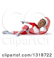 Clipart Of A 3d Young Black Male Christmas Super Hero Santa Resting On His Side And Pointing Royalty Free Illustration by Julos