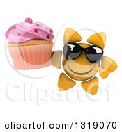 Clipart Of A 3d Happy Sun Character Wearing Sunglasses Holding And Pointing To A Pink Frosted Cupcake Royalty Free Illustration