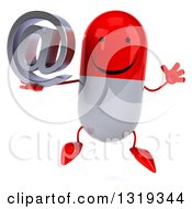 Clipart Of A 3d Happy Red And White Pill Character Jumping And Holding An Email Arobase At Symbol Royalty Free Illustration