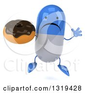 Clipart Of A 3d Unhappy Blue And White Pill Character Jumping And Holding A Chocolate Glazed Donut Royalty Free Illustration