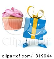 Clipart Of A 3d Happy Blue Gift Character Holding And Pointing To A Pink Frosted Cupcake Royalty Free Illustration by Julos