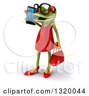 Clipart Of A 3d Bespectacled Green Female Springer Frog Facing Left And Talking On A Smart Cell Phone Royalty Free Illustration