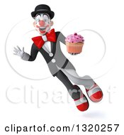 Clipart Of A 3d White And Black Clown Flying Waving And Holding A Pink Frosted Cupcake Royalty Free Illustration