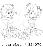 Lineart Clipart Of A Cartoon Black And White Boy And Girl Working Out With Balls And Jump Ropes Royalty Free Outline Vector Illustration