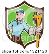 Clipart Of A Cartoon White Male Plumber Holding Out A Monkey Wrench In A Brown White And Green Shield Royalty Free Vector Illustration