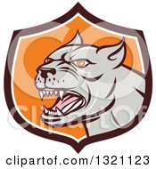 Clipart Of A Cartoon Barking Brown Pitbull Guard Dog Head In A Brown White And Orange Shield Royalty Free Vector Illustration by patrimonio