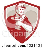 Clipart Of A Retro Male Handy Man Holding A Power Drill In A Red White And Tan Shield Royalty Free Vector Illustration