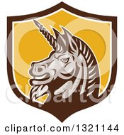 Clipart Of A Retro Woodcut Angry Gray Unicorn Head In A Brown White And Yellow Shield Royalty Free Vector Illustration by patrimonio