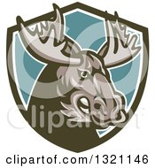 Clipart Of A Retro Snarling Tough Moose In A Green White And Turquoise Shield Royalty Free Vector Illustration by patrimonio