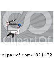 Clipart Of A Cartoon Director Holding Up A Clapper Board And Gray Rays Background Or Business Card Design Royalty Free Illustration
