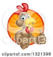Clipart Of A Happy Brown Chicken Or Rooster Mascot Giving A Thumb Up And Emerging From A Sun Ray Circle Royalty Free Vector Illustration