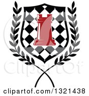 Clipart Of A Red Chess Rook Piece In A Checkered Shield And Wreath Royalty Free Vector Illustration by Vector Tradition SM