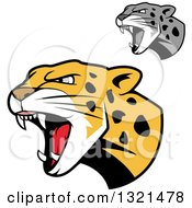 Clipart Of Roaring Angry Jaguar Or Leopard Big Cat Heads Royalty Free Vector Illustration