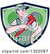Clipart Of A Retro Cartoon White Male Plumber Holding A Giant Monkey Wrench In A Blue White And Green Shield Royalty Free Vector Illustration