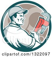 Clipart Of A Retro Male Plumber Holding A Monkey Wrench And Looking To The Side In A Teal White And Tan Circle Royalty Free Vector Illustration by patrimonio