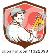 Clipart Of A Retro Male Plumber Holding A Monkey Wrench And Looking To The Side In A Brown White And Red Shield Royalty Free Vector Illustration