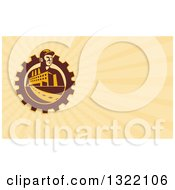 Clipart Of A Retro Factory Worker Mechanic In A Gear With A Building And Pastel Orange Rays Background Or Business Card Design Royalty Free Illustration