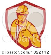Clipart Of A Retro Male Construction Worker Giving A Thumb Up In A Red And Taupe Shield Royalty Free Vector Illustration