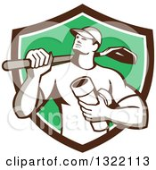 Clipart Of A Retro Drainlayer Man Carrying A Shovel And Pipe In A Brown White And Green Shield Royalty Free Vector Illustration by patrimonio