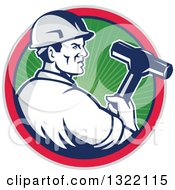 Clipart Of A Retro Male Construction Worker Holding A Sledgehammer In A Green Ray Blue Pink And Gray Circle Royalty Free Vector Illustration