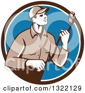 Clipart Of A Retro Male Worker Holding A HDMI Cable And Emerging From A Brown White And Blue Circle Royalty Free Vector Illustration