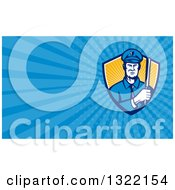 Clipart Of A Retro Male Policeman With A Baton And Blue Rays Background Or Business Card Design Royalty Free Illustration