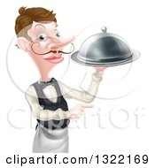 Cartoon Caucasian Male Waiter With A Curling Mustache Pointing And Holding A Cloche Platter