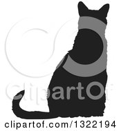 Clipart Of A Black Sitting Cat Silhouette 4 Royalty Free Vector Illustration